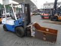 Газ - бензиновий автонавантажувач Nissan UGJ02M30 на 3 тонны